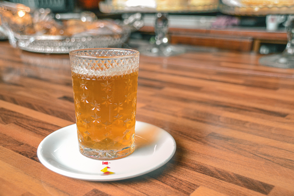 Glass of Moroccan mint tea on counter