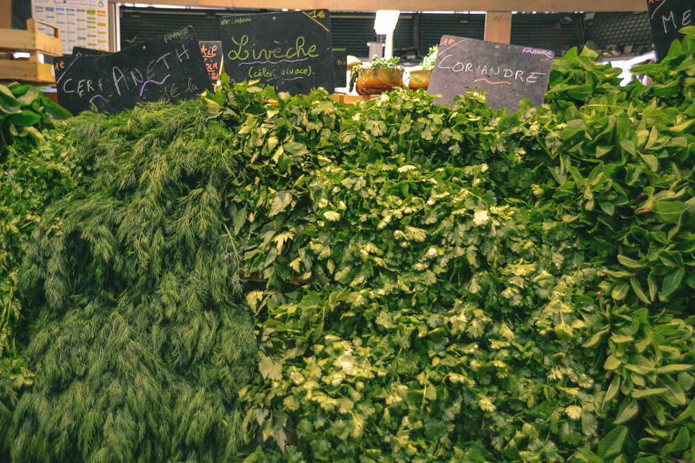Wall of herbs at the Marché des Capucins