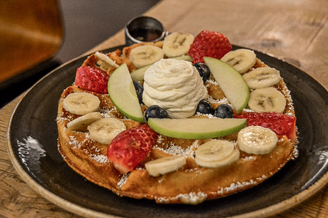 Waffles with fruit, maple syrup, and lime mascarpone cream