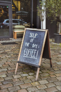 "Chalkboard sign with text ""Soup of the day: Coffee"""