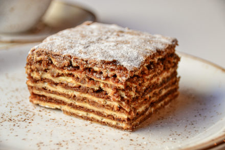 Kukotava - square slice of honey cake on a plate